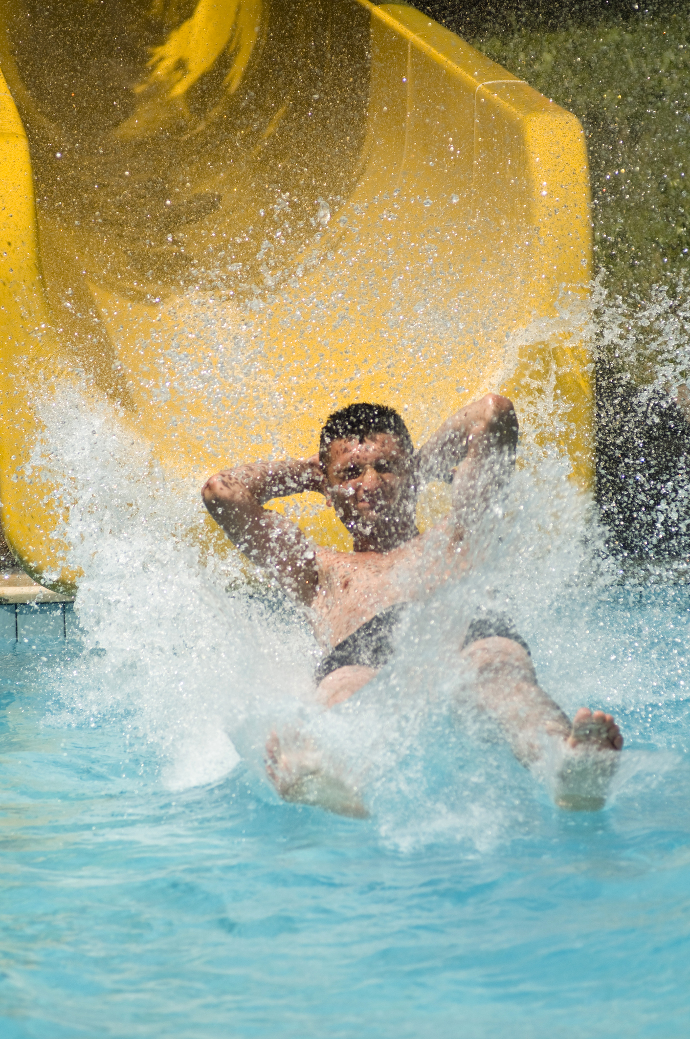 Water park guy coming out of slide