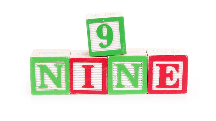 NINE logo image