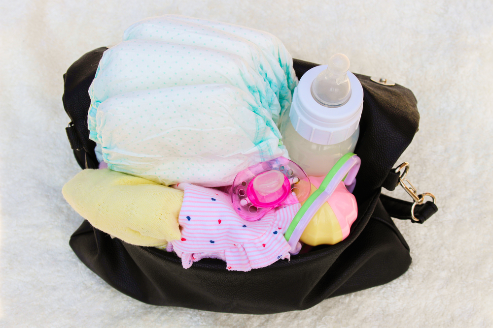 Diaper bag with stuff shutterstock 361311437 2